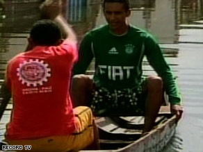 Brazilians take to boats to in the flooded Piaui state, in the  northeastern part of the country.