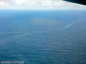 Image released by the Brazilian Air Force shows oil slicks in the water near a debris site.