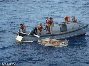 A boat from the Brazilian navy picks up debris in the Atlantic on Sunday.