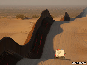 A border patrol vehicle drives along the border between the United States and Mexico on March 14, 2009.