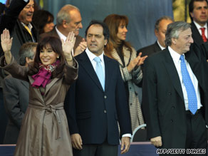 Argentina's First Couple flank Buenos Aires Gov. Daniel Scioli at a campaign rally in the capital Thursday.