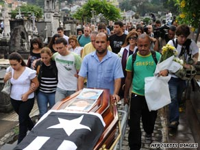 Relatives and friends of an Air France steward follow his coffin during his funeral last week in Rio de Janeiro.