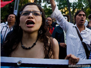 Lucia Morett (L) protests against Colombian President Alvaro Uribe in Mexico City on March 2.