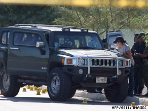 Police check the vehicle where an unidentified man was killed in Ciudad Juarez on Thursday.