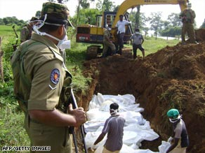 Sri Lankan workers bury the bodies of some 38 suspected Tamil Tiger rebels killed in recent fighting.
