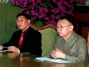 Kim Jong-Il, right, appeared with Chinese official  Wang Jiarui.