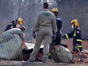 Forensic teams sift through the remains of a house in Pheasant Creek, north of Melbourne.