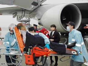 A passenger injured when turbulence struck the NWA flight is taken to hospital.
