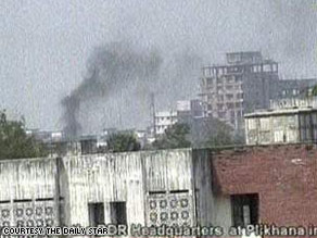 Plumes of smoke billow into the air after a fierce gun battle in the Bangladesh Rifles? headquarters in Dhaka.