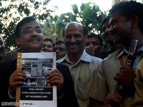 Prosecutor Ujjwal Nikam (left) holds the case file outside the court.