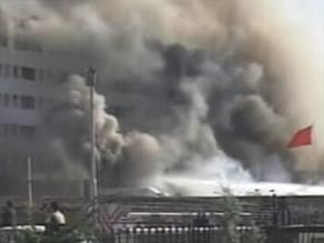 Smoke pours from the Marriott Hotel in Islamabad.