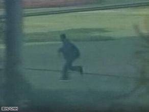 A video grab shows a suspected gunman near Gaddafi Stadium in Lahore, Pakistan, Tuesday.