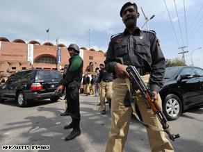 Pakistani policemen outside The National Stadium after masked gunmen attacked the Sri Lankan cricket team in Lahore on March 3, 2009.