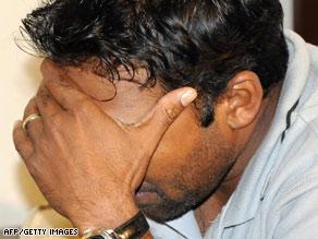 Cricket captain Mahela Jayawardene reacts Wednesday after returning to Sri Lanka's capital, Colombo.