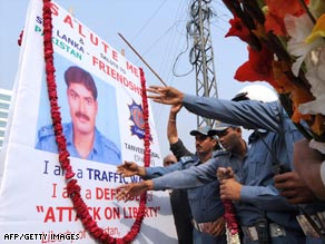 Fellow officers pay tribute to Tanveer Iqbal, one of six policemen killed in Tuesday's attack.
