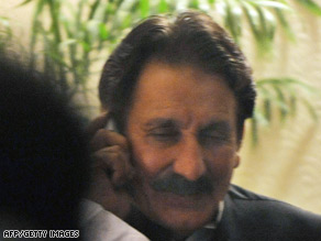 Iftikhar Muhammad Chaudhry is shown speaking on his mobile phone Monday iin Islamabad.