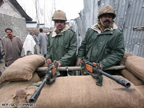 Indian soldiers stand guard in Srinagar.