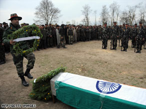 An Indian army soldier lays a wreath during the funeral of a slain soldier, northeast of Srinagar on Tuesday.
