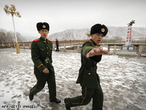 Chinese border guards patrol in Jilin province across from the North Korean border on March 21, 2009.