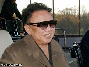 An undated photo of North Korean leader Kim Jong Il relaxing at a football match.