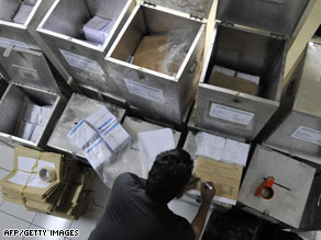 A poll worker prepares ballot boxes in Jakarta on Wednesday on the eve of the parliamentary elections.