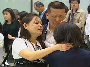 Arlan and Sarah Calderon hug their daughter Noriko farewell.