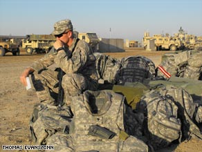 A soldier waits in Baghdad for a flight to his new mission in Kandahar.