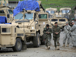 U.S. Army soldiers, right, watch two Afghan soldiers at ISAF's Camp Bostick in Naray, in the eastern Kunar province.