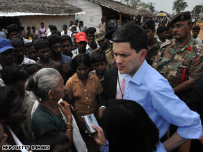 UK Foreign Minister David Miliband talks to displaced Tamil civilians at a camp in north Sri Lanka Wednesday.