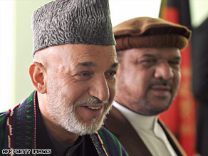 Afghan President Hamid Karzai appears with running mate Mohamed Fahim, a former warlord.