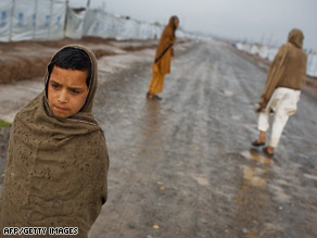 A Pakistani boy walks through a camp in Peshawar, Pakistan, after fleeing Taliban-Pakistani fighting.