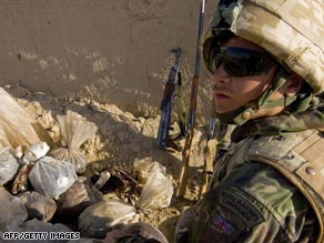 A British marine with an opium haul in Helmand province, where the four soldiers were killed.
