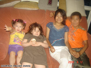 Ren Yan, second from right, and Ren Qiang, far right, hang out with foster sisters Angela and Lian last June.