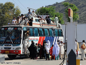 Pakistani civilians pack a bus leaving Mingora, the capital of the troubled Swat Valley.