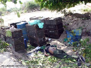 This picture, released by the Sri Lankan defense ministry, is said to be of a dead Tamil Tiger body captured after fighting on May 14, 2009.