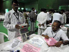 Election officials count votes at a polling center in Hyderabad, India, on Saturday.