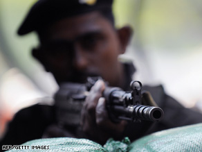A Sri Lankan soldier guards a military checkpoint in the capital Colombo.