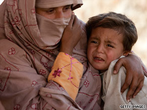 A Pakistani woman holds a child Monday at a displaced persons camp. Millions have fled violence in the country.