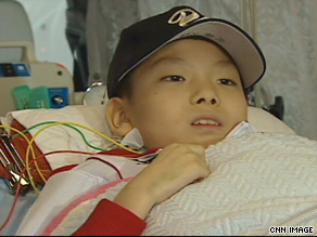 Hiroki in an ambulance on the way to catch his flight to New York, where he will wait for a heart.