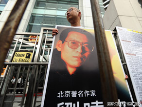 Pro-democracy protesters in Hong Kong demonstrate over Chinese dissident Liu Xiaobo's arrest Thursday.