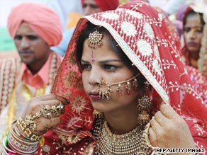 An Indian bride adjusts her headwear during a mass marriage ceremony on the border with Pakistan in April.