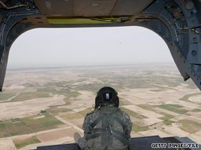 A soldier mans a weapon at the rear of a U.S. Army helicopter over Afghanistan in May.