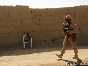 A U.S. Marine patrols Garmser district in Afghanistan's Helmand province on Friday.