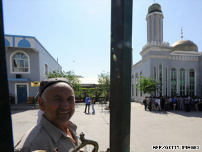 A Chinese Uyghur man opens the gate to a mosque in Urumqi on Thursday during a media tour.
