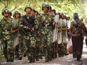 Police are shown on patrol in Urumqi, China, on Saturday, July 11.