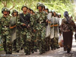Police patrol Urumqi, China, on Saturday, July 11.