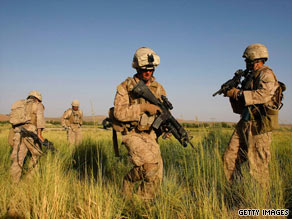 U.S. Marines walk through a field on patrol on July 13, 2009, in Mian Poshteh, Afghanistan .