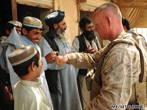 Brig. Gen. Larry Nicholson greets a Helmand resident on July 3.