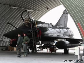 A French Air Force Mirage 2000 sits under a shelter on the tarmac at an airbase in Kandahar on January 1, 2009.