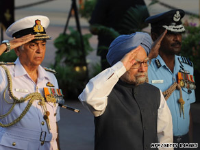Manmohan Singh, center, honors a war victory in New Delhi on Sunday, the same day he launched a sub.